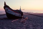 PORTUGAL, CENTRAL, ATLANTIC COAST Traditional fishing boats on the shore at Mira south of Aveiro