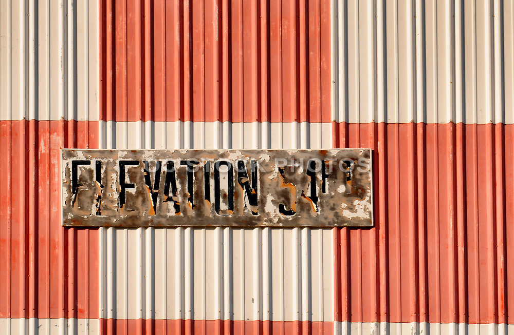 Weathered Elevation Sign on Hangar