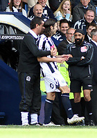 Photo: Mark Stephenson.<br /> West Bromwich Albion v Queens Park Rangers. Coca Cola Championship. 30/09/2007.Qpr's manager John Gregory holds back West Brom's Carl Hoefkens