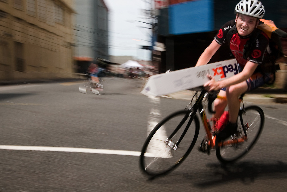 A racer during final race of the 2005 Cycle Messenger World Champions in Jersey City. The races include checkpoints where packages of various sizes must be picked up and delivered, bikes must be locked up, and others where participants must change a tire.