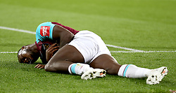 West Ham United's Michail Antonio lies on the pitch after a challenge