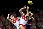 Gary Rohan (centre) and Zak Jones of the Swans competes for the ball with Clay Smith of the Bulldogs during the round 15 AFL match between the Sydney Swans and the Western Bulldogs at Sydney Cricket Ground in Sydney on Saturday, July 2, 2016. (AAP Image/Paul Miller) NO ARCHIVING, EDITORIAL USE ONLY