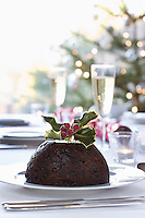 Christmas table with champagne and pudding