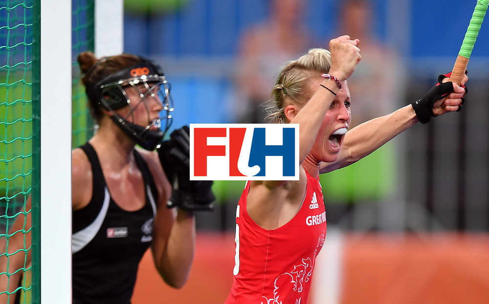Britain's Alex Danson (R) celebrates after scoring the opening goal during the women's semifinal field hockey New Zealand vs Britain match of the Rio 2016 Olympics Games at the Olympic Hockey Centre in Rio de Janeiro on August 17, 2016. / AFP / MANAN VATSYAYANA        (Photo credit should read MANAN VATSYAYANA/AFP/Getty Images)