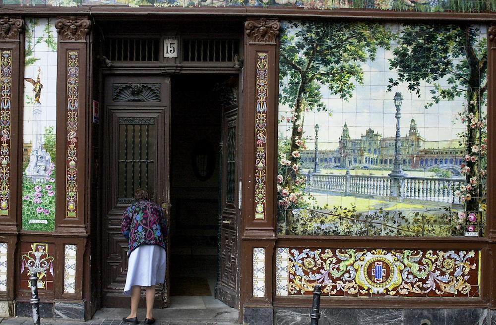 Beautiful old tiles on a tourism shop Casa de Guadalajara, Plaza Santa Ana, Madrid, Spain