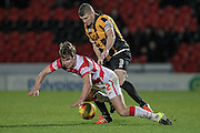 Michael Lund (Doncaster Rovers) is fouled by Carl Dickinson (c) (Port Vale) during the Sky Bet League 1 match between Doncaster Rovers and Port Vale at the Keepmoat Stadium, Doncaster, England on 26 January 2016. Photo by Mark P Doherty.