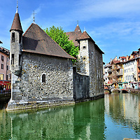 Palais de I'Isle in Annecy, France  <br /> The Palais de I'Isle is the best known landmark and centerpiece of Annecy. Since it was built in 1132, it has housed a lord, a count, law courts, a mint and a prison. Today, it is a history museum focusing on local architecture and heritage.