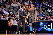 Feb 13, 2017; Phoenix, AZ, USA; Phoenix Suns head coach Earl Watson high fives guard Devin Booker (1) in the first half of the NBA game against the New Orleans Pelicans at Talking Stick Resort Arena. Mandatory Credit: Jennifer Stewart-USA TODAY Sports