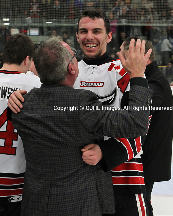GEORGETOWN, ON  - APR 26,  2017: Ontario Junior Hockey League, Championship Series. Georgetown Raiders vs the Trenton Golden Hawks in Game 7 of the Buckland Cup Final. The post game celebration of the 2017 Buckland Cup Championship between Josh Dickinson and Team Owner Bill Court.<br /> (Photo by Tim Bates / OJHL Images)