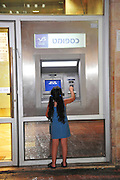 Israel, Jerusalem, Girl of eight draws out money from an ATM Model Release Available