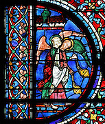 2 thurifers or incense-bearer angels, to the left of the Assumption of the Virgin, from the Glorification of the Virgin stained glass window, in the nave of Chartres Cathedral, Eure-et-Loir, France. This window depicts the end of the Virgin's life on earth, her dormition and assumption, as told in the apocryphal text the Golden Legend of 1260. Chartres cathedral was built 1194-1250 and is a fine example of Gothic architecture. Most of its windows date from 1205-40 although a few earlier 12th century examples are also intact. It was declared a UNESCO World Heritage Site in 1979. Picture by Manuel Cohen