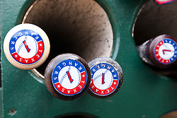 OAKLAND, CA - APRIL 07:  Detailed view of baseball bats belonging to Elvis Andrus (not pictured) of the Texas Rangers in the dugout before the game against the Oakland Athletics at O.co Coliseum on April 7, 2015 in Oakland, California. The Texas Rangers defeated the Oakland Athletics 3-1. (Photo by Jason O. Watson/Getty Images) *** Local Caption ***