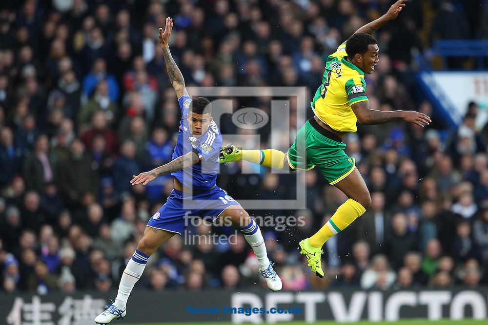 Kenedy of Chelsea and Andre Wisdom of Norwich in aerial action during the Barclays Premier League match at Stamford Bridge, London<br /> Picture by Paul Chesterton/Focus Images Ltd +44 7904 640267<br /> 21/11/2015