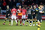 Players shake hands at full time during the EFL Sky Bet League 2 match between Salford City and Crawley Town at the Peninsula Stadium, Salford, United Kingdom on 8 February 2020.