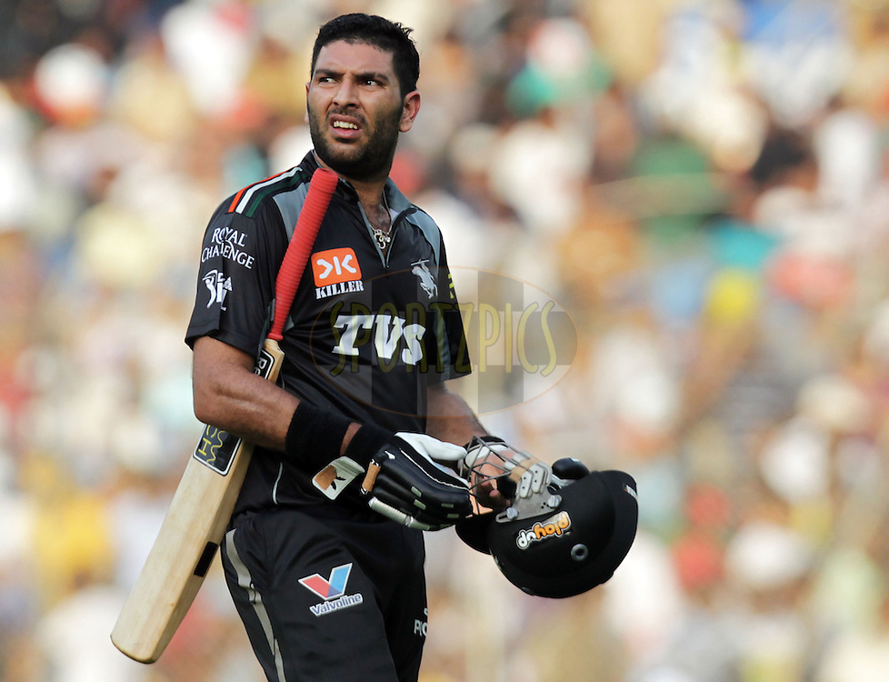 Pune Warriors captain Yuvraj Singh walks bat after scoring a fifty during  match 31 of the Indian Premier League ( IPL ) Season 4 between the Pune Warriors and the Chennai Superkings held at the Dr DY Patil Sports Academy, Mumbai India on the 27th April 2011..Photo by BCCI/SPORTZPICS .
