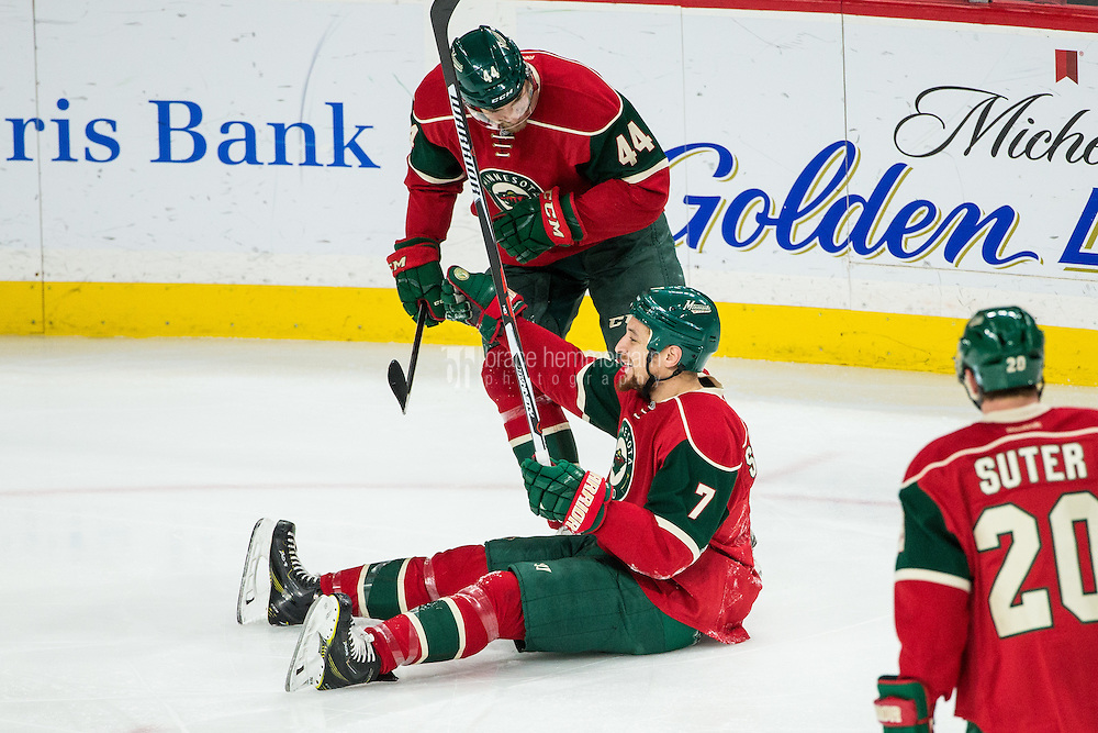 Dec 17, 2016; Saint Paul, MN, USA; Minnesota Wild forward Chris Stewart (7) scores a goal during the third period against the Arizona Coyotes at Xcel Energy Center. The Wild defeated the Coyotes 4-1. Mandatory Credit: Brace Hemmelgarn-USA TODAY Sports