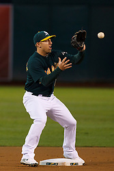 June 28, 2011; Oakland, CA, USA; Oakland Athletics shortstop Cliff Pennington (2) catches the ball at second base to force an out against the Florida Marlins during the first inning at the O.co Coliseum.  Oakland defeated Florida 1-0.