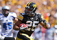 September 4 2010: Iowa Hawkeyes running back Paki O'Meara (25) runs back a blocked punt for a touchdown during the first quarter of the NCAA football game between the Eastern Illinois Panthers and the Iowa Hawkeyes at Kinnick Stadium in Iowa City, Iowa on Saturday September 4, 2010. Iowa defeated Eastern Illinois 37-7.