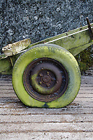 Flat tire on trailer, moss covered, in farm in Ireland