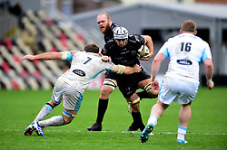 Ollie Griffiths of Dragons is tackled by Callum Gibbins of Glasgow Warriors - Ryan Hiscott/JMP - 25/10/19 - SPORT - Rodney Parade - Newport, Wales -