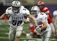Xavier tailback Pat Chizek (23) looks for a block from tackle Alex Boyer (58) in their Class 4A semifinal game at the UNI Dome in Cedar Falls on Friday November 13, 2009.