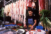 01 DECEMBER 1988  - HONG KONG: Vendor selling squid in the night market on Hong Kong. PHOTO © JACK KURTZ  FOOD  ECONOMY