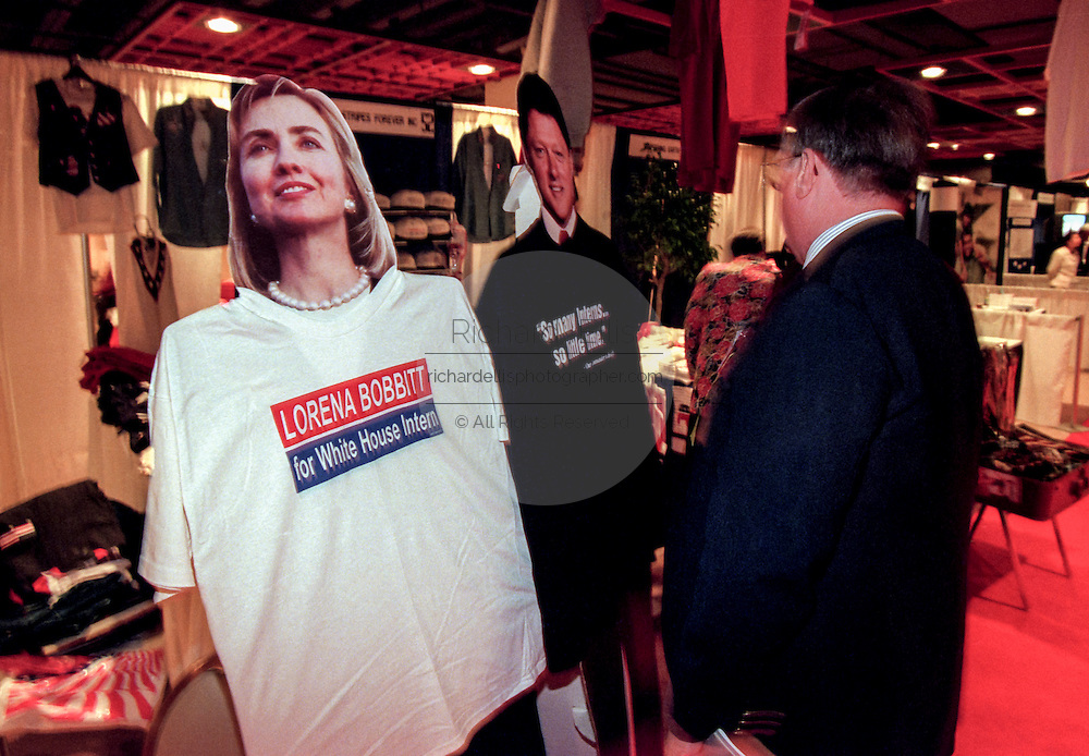 An attendee at the Road to Victory event at the Christian Coalition Conference views conservative slogans on sale September 19, 1998 in Washington, DC.