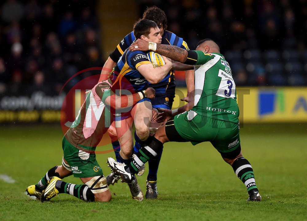 Worcester Warriors Fly-Half Tom Heathcote is tackled by Blair Cowan openside flanker for London Irish and Halani Aulika tighthead prop for London Irish  - Mandatory by-line: Joe Meredith/JMP - 26/03/2016 - RUGBY - Sixways Stadium - Worcester, England - Worcester Warriors v London Irish - Aviva Premiership