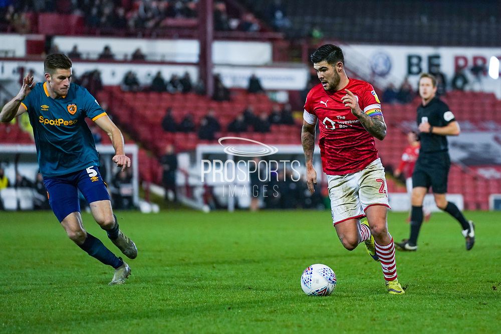 Barnsley midfielder Alex Mowatt (27) in action during the EFL Sky Bet Championship match between Barnsley and Hull City at Oakwell, Barnsley, England on 30 November 2019.