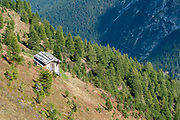 wooden forest rangers shelter on the summit of Mount Elfer, Stubaital, Tyrol, Austria