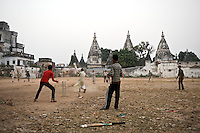 Boys play games of cricket against a backdrop of centuries-old temples in the ancient city of Varanasi which rests along the banks of the Ganges River, India.