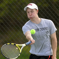 Staff photos by Tom Kelly IV<br /> Strath Haven's Jeff Painter returns a shot to Harriton's Isaac Goldenberg during the Harriton at Strath Haven boys tennis match on Tuesday afternoon.