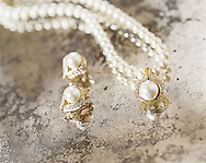 This photograph of pearl jewelry is shot on an antique mirror on location during a fashion photograph for Chalres Keath.