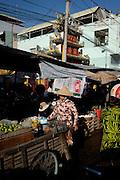 A woman walks through the market in Chau Doc, Vietnam.