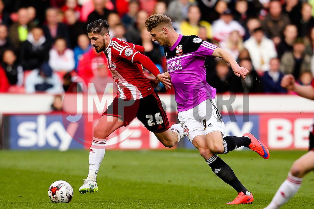 Kieron Freeman of Sheffield United is chased by Michael Smith of Swindon Town - Photo mandatory by-line: Matt McNulty/JMP - Mobile: 07966 386802 - 07/05/2015 - SPORT - Football - Sheffield - Bramall Lane - Sheffield United v Swindon Town - Sky Bet League One