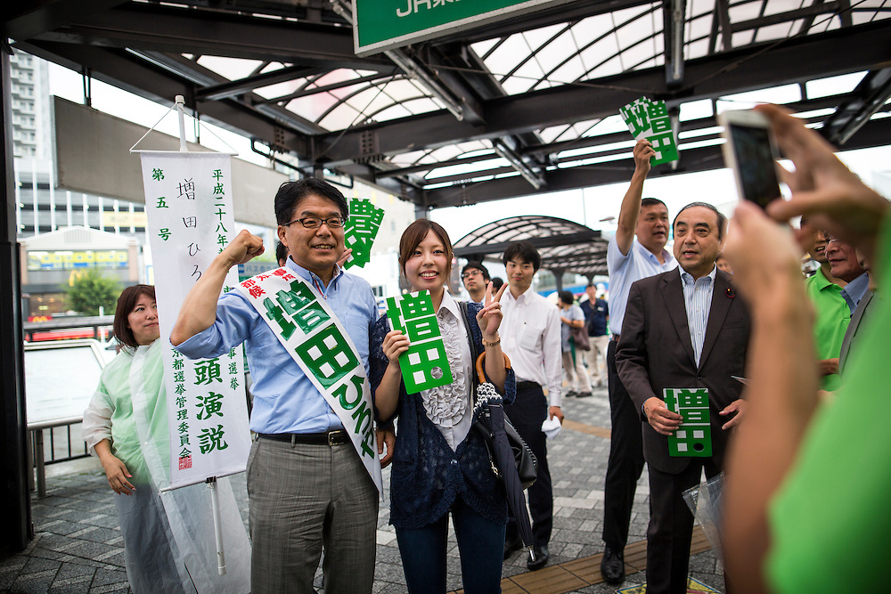 TOKYO, JAPAN - JULY 21 : Candidate Hiroya Masuda takes photo with people during a Tokyo Gubernatorial Election 2016 campaign rally at Kanamachi Station, Tokyo, Japan on Thursday, July 21, 2016. Tokyo residents will vote on July 31 for a new Tokyo Governor who will deal with issues related to hosting the Summer Tokyo Olympics and Paralympics in 2020. (Photo: Richard Atrero de Guzman/NUR Photo)