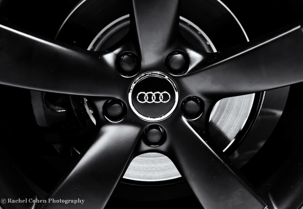 &quot; Audi Wheel&quot; 2 mono<br /> <br /> A beautiful monochrome image of the awesome Audi wheel and logo!!<br /> <br /> Cars and their Details by Rachel Cohen