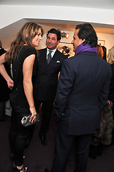 Left to right, ELIZABETH HURLEY, GIORGIO VERONI and ARUN NAYER at a private view of photographs by Anthony Souza held at The Little Black Gallery, 13A Park Walk, London SW10 on 13th December 2011.