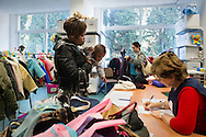 "Rome, Italy. Italian and foreign women within the Salva Mamme Center, choosing clothes for their children. The Center offers psychological and material support to families in severe economic and social conditions. In the land of ""la dolce vita"" life is becoming bitter reporting that 8 million Italians are ""living in poverty""."