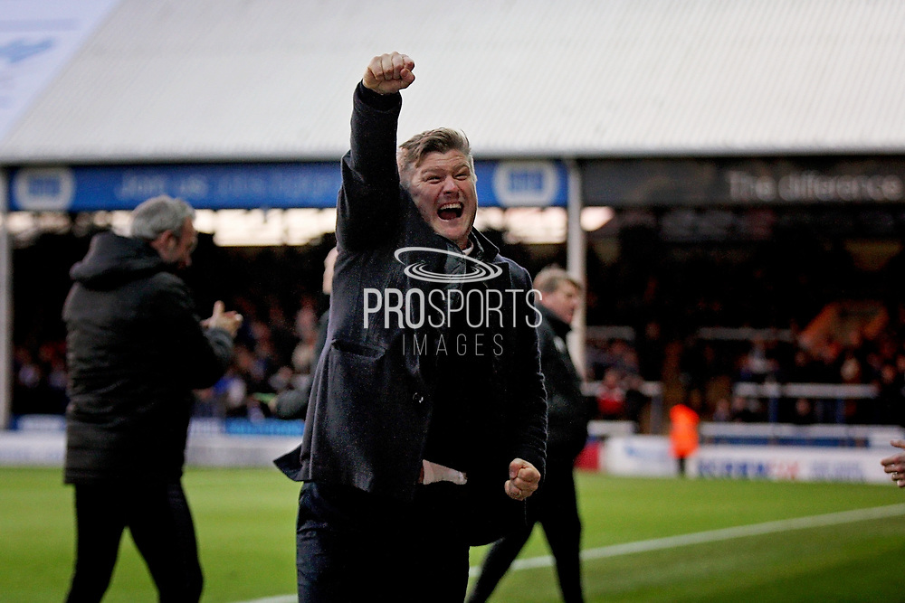 Oxford United's manager Karl Robinson celebrates his teams first goal during the EFL Sky Bet League 1 match between Peterborough United and Oxford United at London Road, Peterborough, England on 8 December 2018.