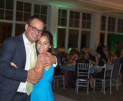 father and his daughter at her Bat Mitzvah celebration
