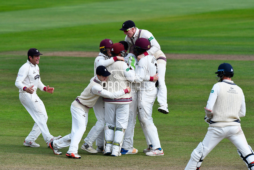 Wicket and win - Jack Leach of Somerset is mobbed as he celebrates taking the final wicket of James Harris of Middlesex to beat Middlesex and secure survival in division 1 of the Specsavers County Champ Div 1 match between Somerset County Cricket Club and Middlesex County Cricket Club at the Cooper Associates County Ground, Taunton, United Kingdom on 28 September 2017. Photo by Graham Hunt.