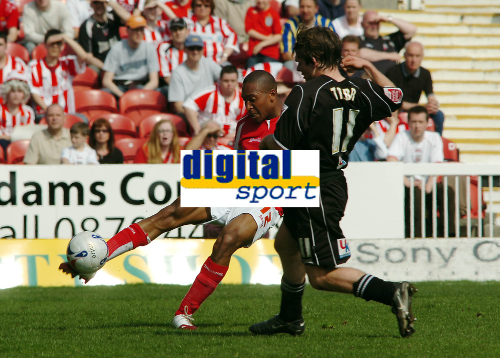 Photo: Kevin Poolman.<br />Swindon Town v Brentford. Coca Cola League 1. 22/04/2006.Swindon's Ricky Shakes clears the ball from Jay Tabb (Brentford).