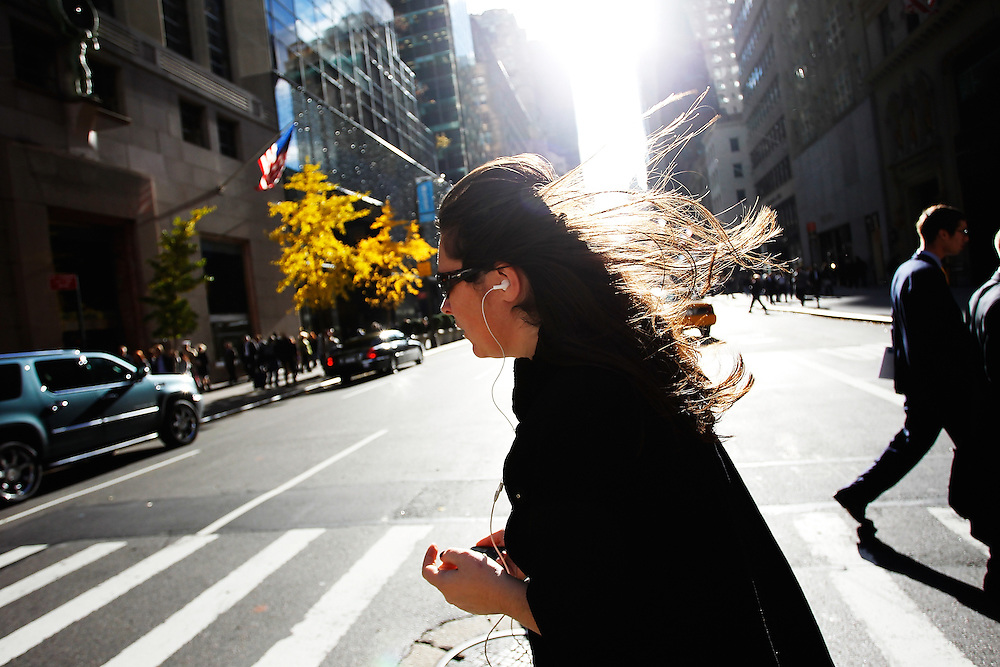 A women Crosses Fifth Avenue and 57th street in Mid-Town Manhattan as winds blow at over 20 mph on Wednesday November 17, 2010 in New York city. .Photo by: Joe Kohen for The Wall Street Journal..nyheardtuesday.