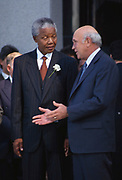 President-elect Nelson Mandela with his deputy presidents F.W de Klerk after the inaugural sitting of South Africa&rsquo;s first all-race parliament on May 9, 1994. <br /> <br /> Photograph &copy; nic bothma