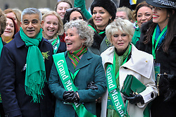 © Licensed to London News Pictures. 18/03/2018. LONDON, UK. (L to R) Sadiq Khan, Mayor of London, with Imelda Staunton, actress, and Gloria Hunniford, presenter, acting as Grand Marshalls for the parade. The 16th annual London St. Patrick's Day parade takes place through central London.  Tens of thousands of people enjoy the parade as well as festivities in Trafalgar Square.  The event showcases the best of Irish food, music, song, dance, culture and arts and this year, celebrates the achievements and successes of London's Irish women as part of the Mayor of London's #BehindEveryGreatCity campaign.   Photo credit: Stephen Chung/LNP