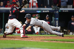 October 11, 2017 - Cleveland, OH, USA - The New York Yankees' Todd Frazier slides safely ahead of the tag from Cleveland Indians catcher Roberto Perez, left, as he scores on a two-run single by Brett Gardner in the ninth inning during Game 5 of the American League Division Series, Wenesday, Oct. 11, 2017, at Progressive Field in Cleveland. The Yankees advanced with a 5-2 win. (Credit Image: © Phil Masturzo/TNS via ZUMA Wire)