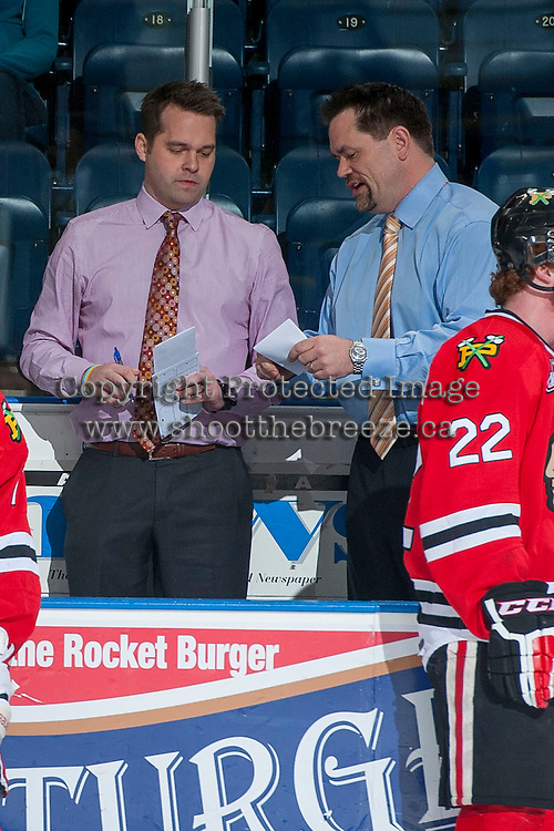 KELOWNA, CANADA - APRIL 25: Kyle Gustafson and Karl Taylor, assistant coaches of the Portland Winterhawks discuss strategy on the bench during warm up against the Kelowna Rockets on April 25, 2014 during Game 5 of the third round of WHL Playoffs at Prospera Place in Kelowna, British Columbia, Canada. The Portland Winterhawks won 7 - 3 and took the Western Conference Championship for the fourth year in a row earning them a place in the WHL final.  (Photo by Marissa Baecker/Getty Images)  *** Local Caption *** Karl Taylor; Kyle Gustafson;