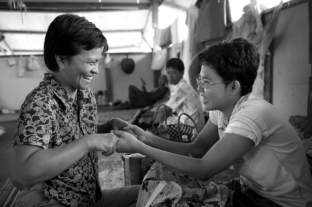 Australian volunteer and health care worker, Kanchana Thorton, with Ma Wint War Thaw, an 18 year old with Arterio venus malformation. Ma Wint War Thaw was having treatment in Burma that ran out when Doctors told her they didn't have the resources, telling her she should go to a foreign hospital. Her father sold up family belongings to make the trip to the clinic. .The Mae Tao Clinic (MTC), founded and directed by Dr. Cynthia Maung, provides free health care for refugees, migrant workers, and other individuals who cross the border from Burma to Thailand in search of of medical treatment.