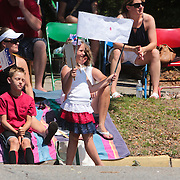 Spectators watch the North Carolina 4th of July Festival Parade Friday July 4, 2014 in Southport, N.C.